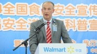Walmart China chief compliance officer Paul Gallemore announcing increased investment