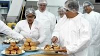 DuPont executives inspect the Singapore ingredients lab with chief science officer Douglas Muzyka (second left) in tow.
